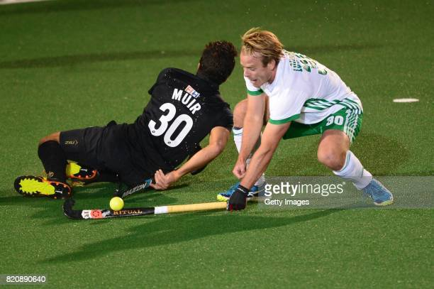 Phillips Hayden of New Zealand and Stephen Cole of Ireland during day 8 of the FIH Hockey World League Men's Semi Finals 5th6th place match between...