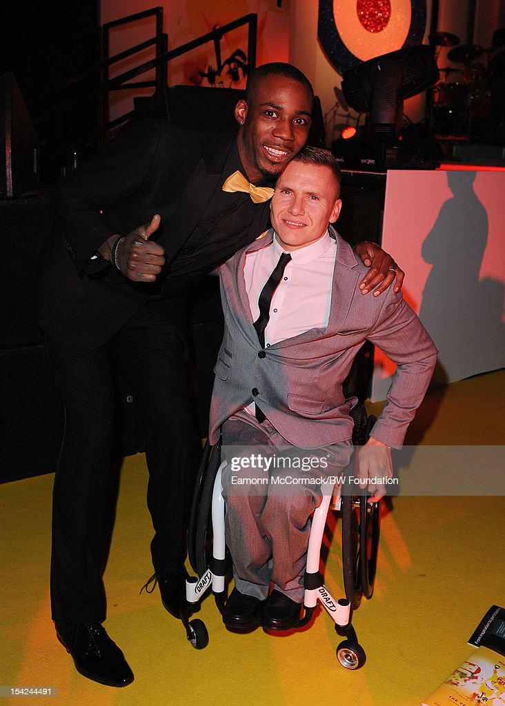 Phillips Idowu and David Weir attends the Bradley Wiggins Foundation 'The Yellow Ball' event at The Roundhouse on October 16, 2012 in London, England. The dinner and entertainment show was held to celebrate the historic achievements of Great Britain's cyclist Bradley Wiggins in 2012, including his Tour de France win and Olympic gold achievements. The Foundation aims to promote participation in sport, to encourage young people to exercise regularly, and to support athletes from all sports to take their talent to the next level.