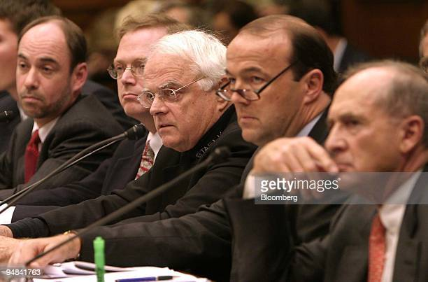 Phillips W Smith CEO and Chairman Taser International Inc third from left tesifies before the Financial Services Subcommittee on 'The FASB Stock...