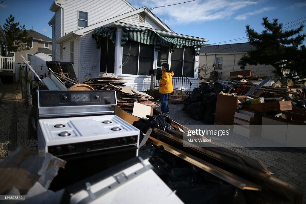 Phillis Boyle stands in front of her house that was flooded by Superstorm Sandy, on November 24, 2012 in Long Beach Island, New Jersey. New Jersey Gov. Christie estimated that Superstorm Sandy will cost New Jersey $29.4 billion in damage and economic losses.
