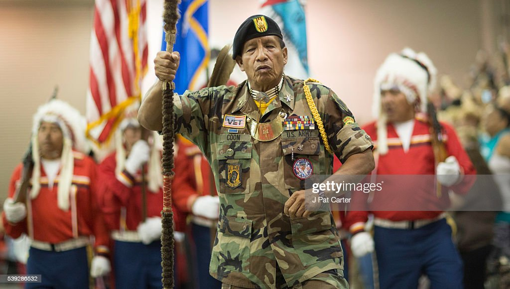 Phillp Coon, a Creek/Seminole, Vietnam Veteran leads the grand entry at the Red Earth Native American Festival, Friday, June 10, 2016 in Oklahoma City.