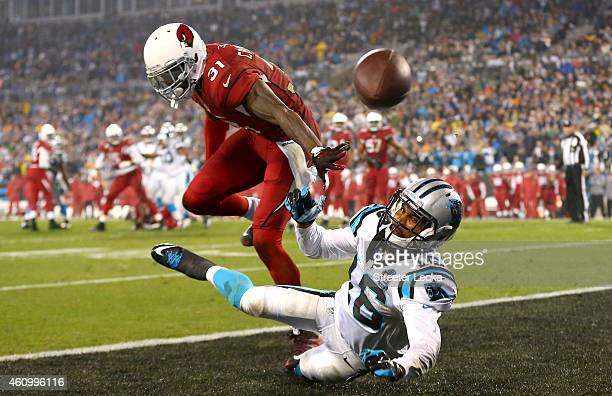 Philly Brown of the Carolina Panthers attempts to catch a pass while being guarded by Antonio Cromartie of the Arizona Cardinals during their NFC...