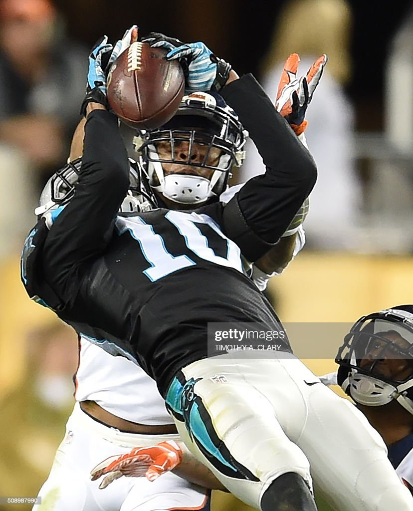 Philly Brown (L) of the Carolina Panthers is pursued by T.J. Ward (C) and Aqib Talib (R) of the Denver Broncos during Super Bowl 50 at Levi's Stadium in Santa Clara, California February 7, 2016. / AFP / TIMOTHY A. CLARY
