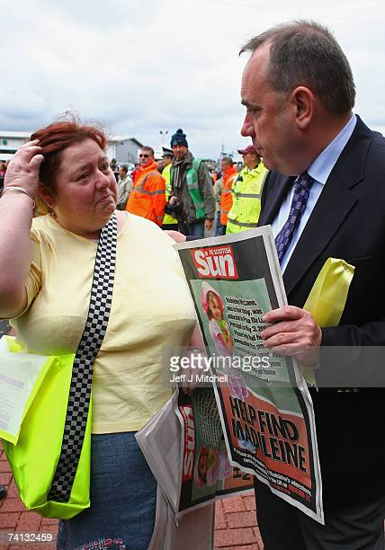 Philomena McCann aunt of Madeleine McCann hands SNP leader Alex Salmond a poster outside Celtic Park on May 12 2007 in Glasgow Scotland The three...