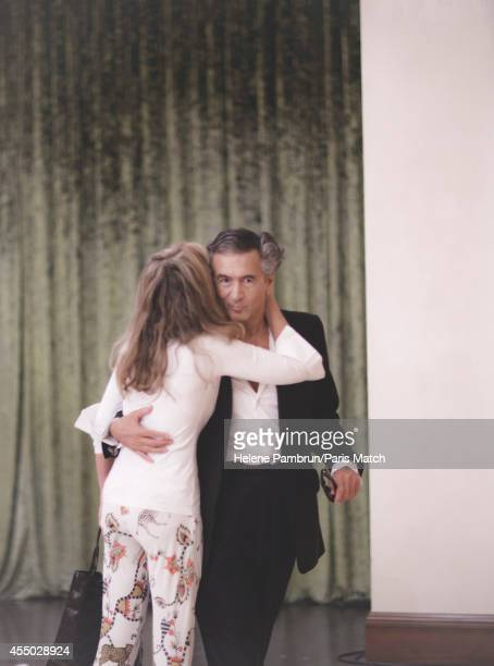 Philosopher and writer Bernard Henri Levy is photographed with his wife Arielle Dombasle for Paris Match whilst presenting his new work Hotel Europe...