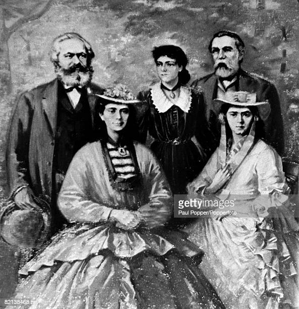 circa 1870's German philosopher economist and social theorist Karl Marx left with his daughters and Friedrich Engels German social phiosopher and...