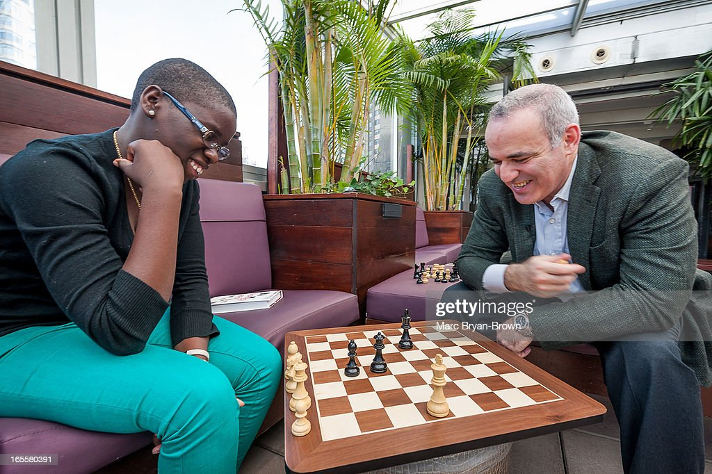 Phiona Mutesi and Gary Kasparov attend Women in the World Summit 2013 on April 4, 2013 in New York, United States.