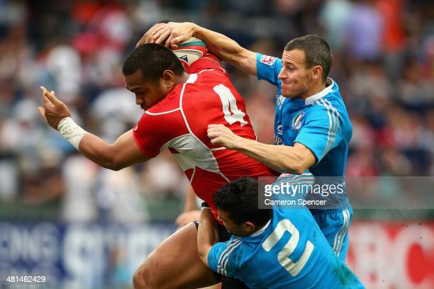 Phiva Lotoahea of Japan is tackled during the Qualifier final between Italy and Japan during the 2014 Hong Kong Sevens at Hong Kong International...