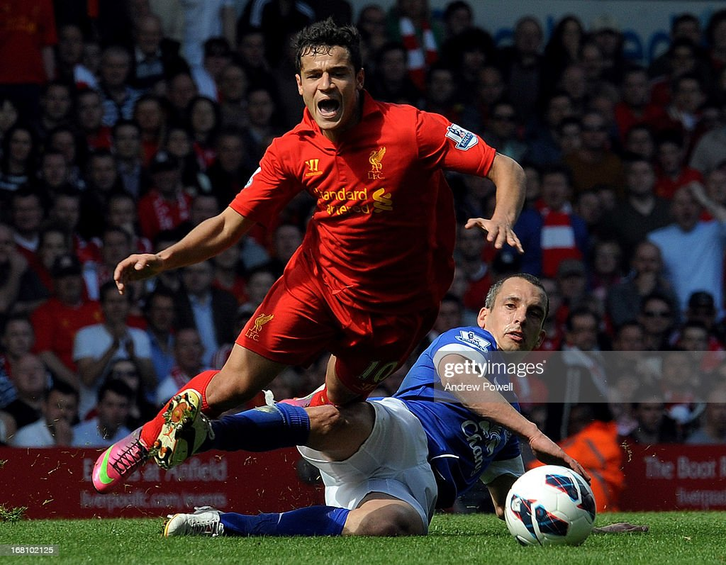 Phlippe Coutinho of Liverpool is brought down by Leon Osman of Everton during the Barclays Premier League match between Liverpool and Everton at Anfield on May 5, 2013 in Liverpool, England.