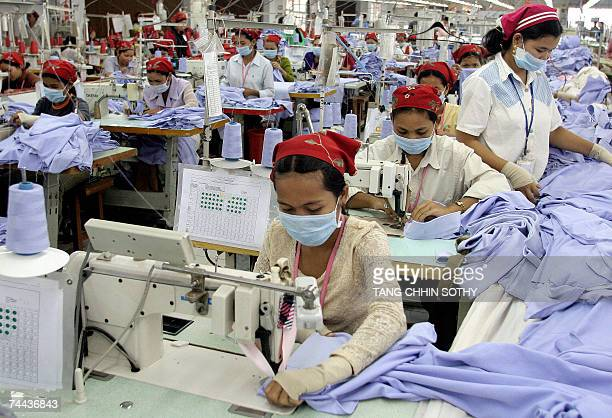 In this picture taken 13 October 2006 Cambodian garment workers are busy at a factory in Phnom Penh Cambodia's parliament approved 08 June 2007 a...