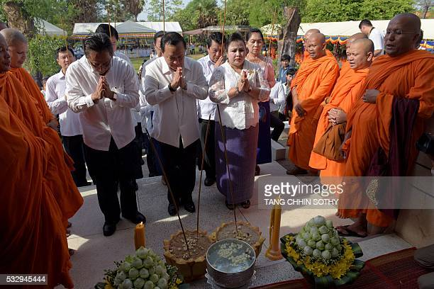 Phnom Penh governor Pa Socheatvong and government officials pray in front of skulls during the annual 'Day of Anger' at the Choeung Ek killing fields...