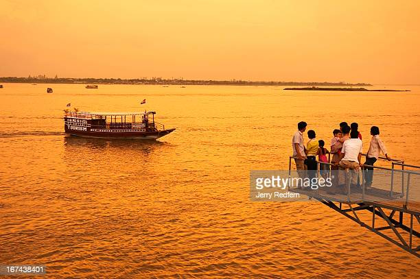 Phnom Phenois take in the evening along the Tonle Sap river watching the river and tour boats roll by