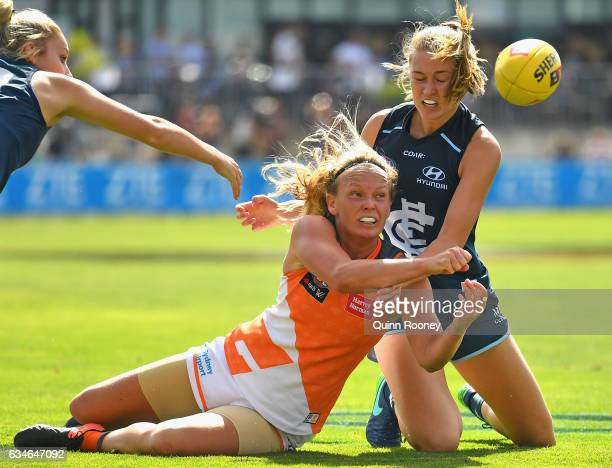 Phoebe McWilliams of the Giants handballs whilst being tackled during the round two AFL Women's match between the Carlton Blues and the Greater...