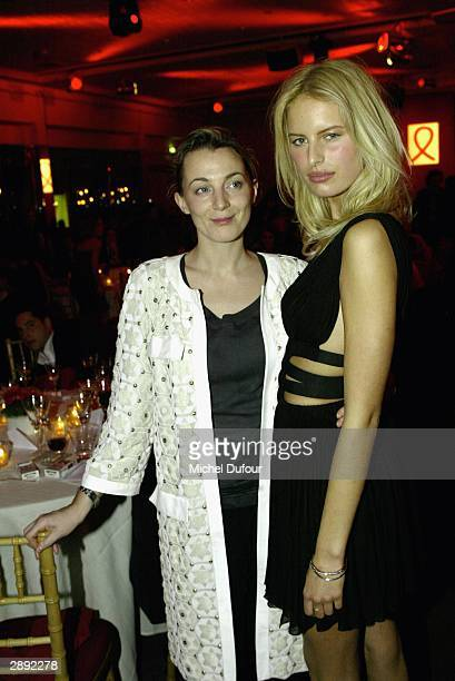 Phoebe Philo with top model Karolina Kurkova attend the Aids Gala Fashion Show during Paris Fashion Week on January 21 2004 in Paris France
