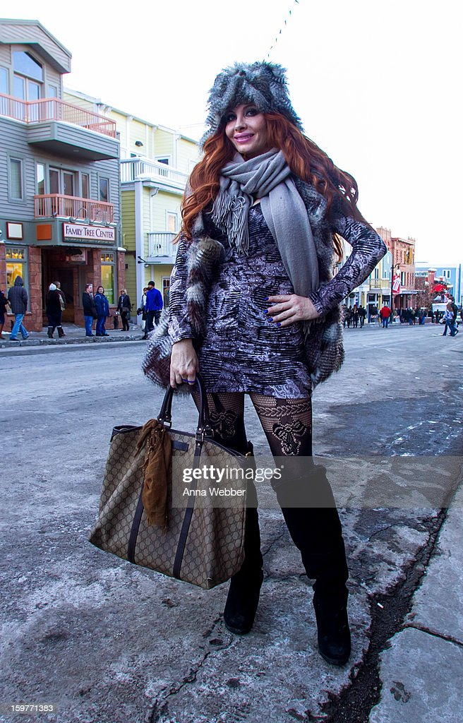 Phoebe Price, actress from Los Angeles, wearing Phoebe Price Designs fur hat, Phoebe Price Designs dress, Neiman Marcus scarf, Gucci bag, and Bearpaws boots on January 19, 2013 on the streets of Park City, Utah.
