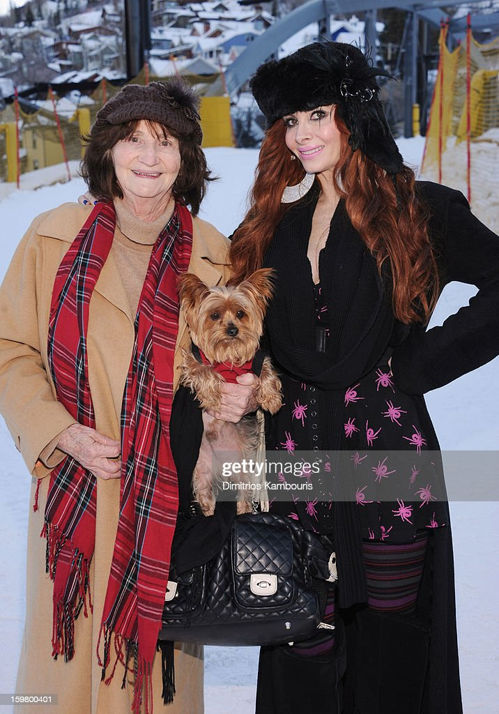 Phoebe Price (R) poses with her mother and dog during Day 3 of Village At The Lift 2013 on January 20, 2013 in Park City, Utah.