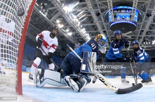 Phoebe Stanz of Switzerland scores a goal in the second period against Noora Raty of Finland during the Women's Ice Hockey Preliminary Round Group A...