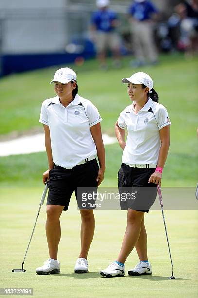 Phoebe Yao of Chinese Taipei talks with her teammate Yani Tseng on the ninth hole during round one of the International Crown on July 24 2014 in...