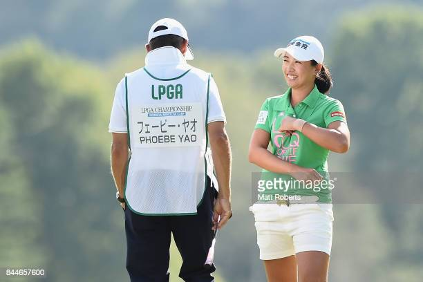 Phoebe Yao of Taiwan shares a laugh with her caddie during the third round of the 50th LPGA Championship Konica Minolta Cup 2017 at the Appi Kogen...
