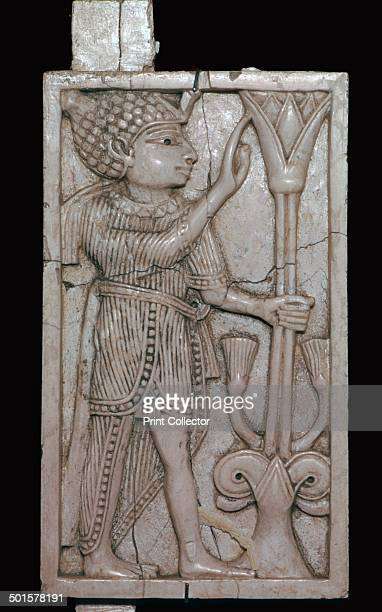 Phoenician ivory panel from a piece of furniture probably made for export to Egypt Found at the Burnt Palace in Nimrud from the British Museum's...