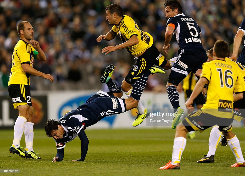 Phoenix and Victory players jump for a high ball during the round four A-League match between Melbourne Victory and Wellington Phoneix at Etihad Stadium on November 4, 2013 in Melbourne, Australia.