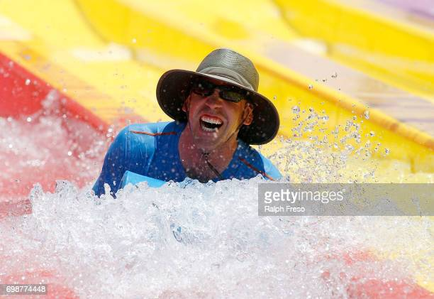 Phoenix area resident finds some relief from the heat on a water slide at the WetNWild Water Park on June 20 2017 in Phoenix Arizona Record...