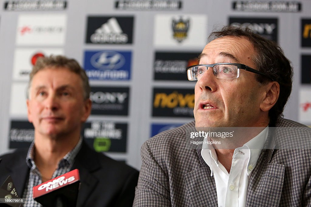 Phoenix chairman Rob Morrison speaks to media while newly appointed Phoenix coach Ernie Merrick looks on during a Wellington Phoenix A-league press conference at Westpac Stadium on May 20, 2013 in Wellington, New Zealand.