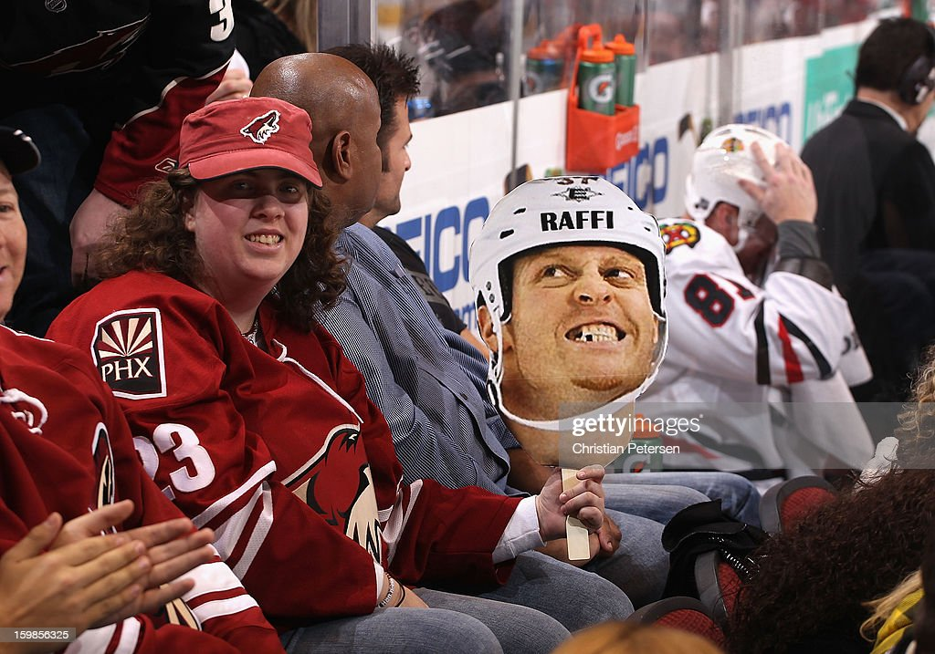 A Phoenix Coyotes fan holds up a Raffi Torres face cut out as <a gi-track='captionPersonalityLinkClicked' href=/galleries/search?phrase=Marian+Hossa&family=editorial&specificpeople=202233 ng-click='$event.stopPropagation()'>Marian Hossa</a> #81 of the Chicago Blackhawks sits in the penalty box during the NHL game at Jobing.com Arena on January 20, 2013 in Glendale, Arizona. The Blackhawks defeated the Coyotes 6-4.
