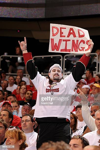 Phoenix Coyotes fan holds up a sign that taunts the Detroit Red Wings fans in Game One of the Western Conference Quarterfinals during the 2010 NHL...