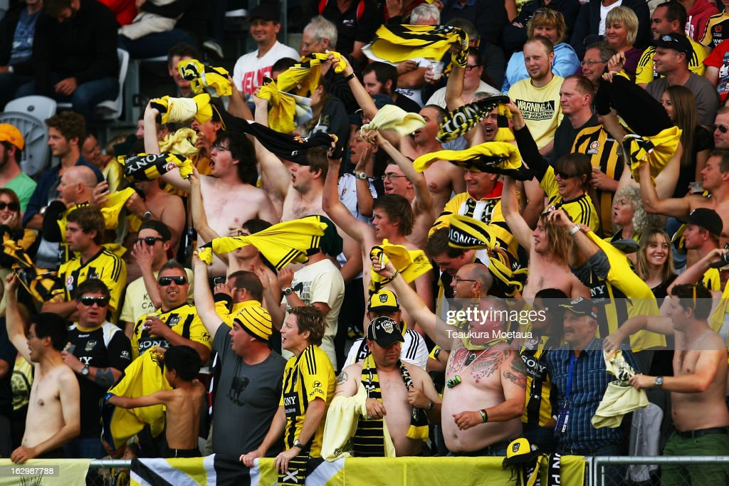 Phoenix fans celebrate during the round 23 A-League match between the Wellington Phoenix and the Melbourne Heart at Forsyth Barr Stadium on March 3, 2013 in Dunedin, New Zealand.