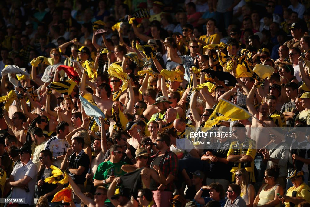 Phoenix fans wave their shirts during the round 19 A-League match between the Wellington Phoenix and the Perth Glory at Eden Park on February 2, 2013 in Auckland, New Zealand.