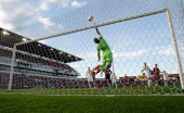 Phoenix goalkeeper Glenn Moss pushes the ball over the bar during the round 24 ALeague match between the Newcastle Jets and Wellington Phoenix at...