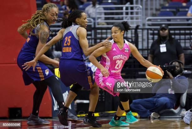 Phoenix Mercury center Brittney Griner and Phoenix Mercury forward Monique Currie defend against Washington Mystics guard Kristi Toliver during a...