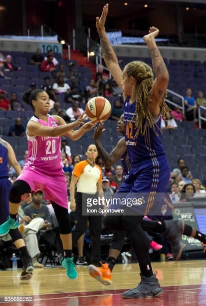 Phoenix Mercury center Brittney Griner guards against Washington Mystics guard Kristi Toliver during a WNBA game on August 18 between the Washington...
