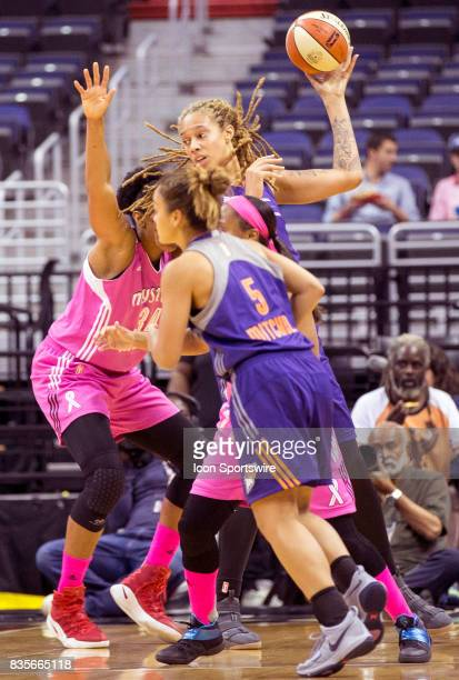 Phoenix Mercury center Brittney Griner holds the ball over Washington Mystics center Krystal Thomas during a WNBA game on August 18 between the...