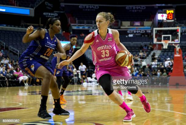 Phoenix Mercury forward Camille Little guards Washington Mystics center Emma Meesseman during a WNBA game on August 18 between the Washington Mystics...