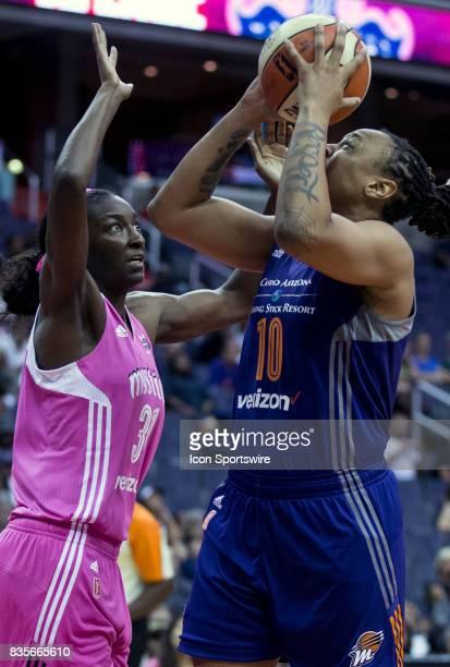 Phoenix Mercury forward Emma Cannon shoots over Washington Mystics forward Asia Taylor during a WNBA game on August 18 between the Washington Mystics...