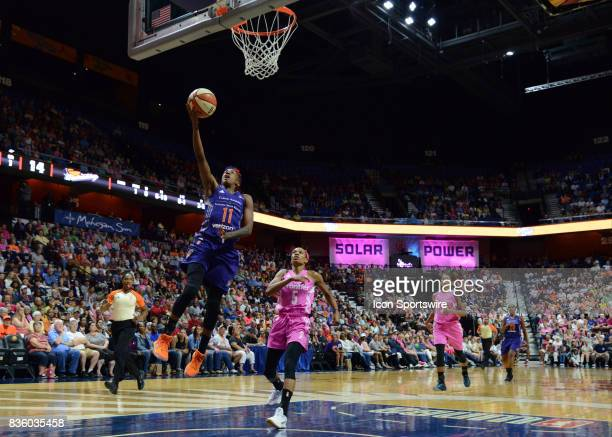 Phoenix Mercury Guard Danielle Robinson scores during a fast break opportunity during the game as the Connecticut Sun host the Phoenix Mercury on...