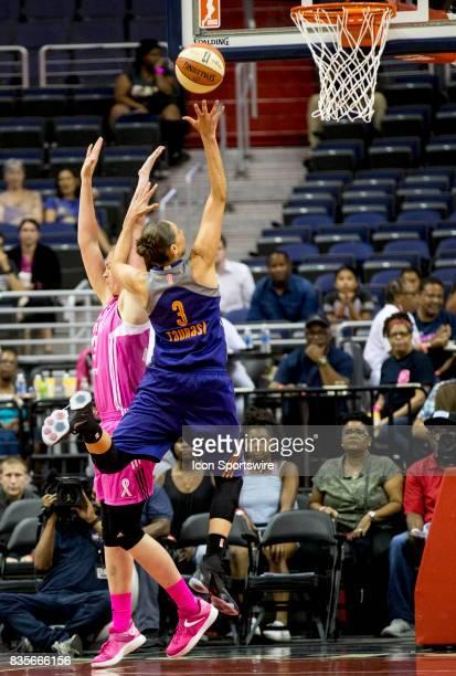 Phoenix Mercury guard Diana Taurasi shoots over Washington Mystics center Emma Meesseman during a WNBA game on August 18 between the Washington...
