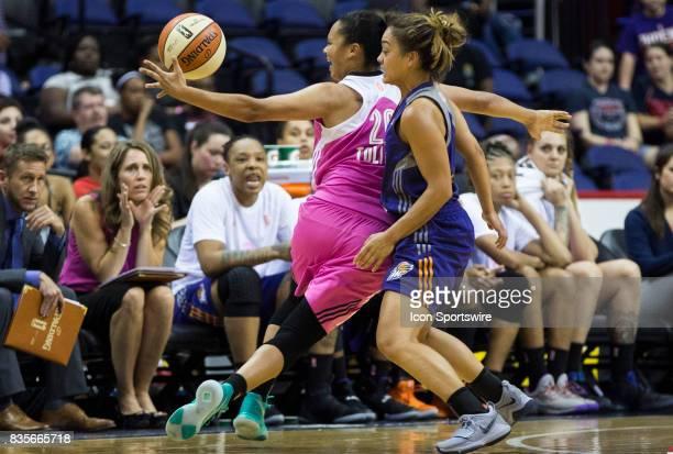 Phoenix Mercury guard Leilani Mitchell blocks Washington Mystics guard Kristi Toliver during a WNBA game on August 18 between the Washington Mystics...