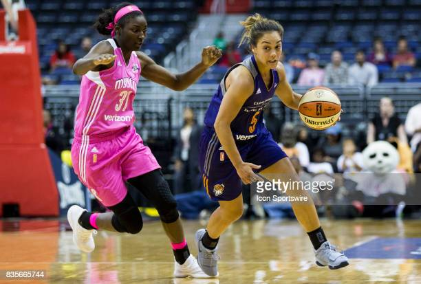 Phoenix Mercury guard Leilani Mitchell dribbles away from Washington Mystics forward Asia Taylor during a WNBA game on August 18 between the...