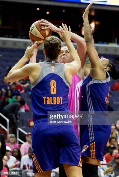 Phoenix Mercury guard Stephanie Talbot and forward Emma Cannon gang up on Washington Mystics center Emma Meesseman during a WNBA game on August 18...