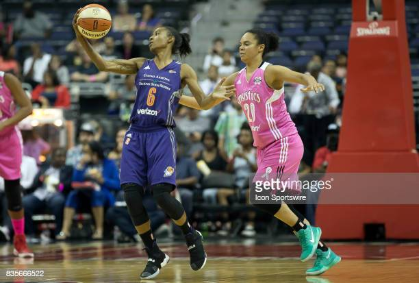 Phoenix Mercury guard Yvonne Turner catches the ball in front of Washington Mystics guard Kristi Toliver during a WNBA game on August 18 between the...