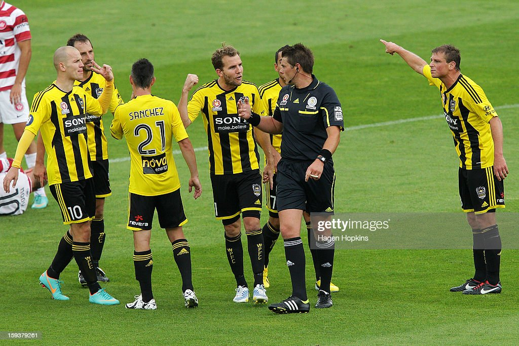 Phoenix players argue with referee Shaun Evans after giving a yellow card to Dani Sanchez of the Phoenix during the round 16 A-League match between the Wellington Phoenix and the Western Sydney Wanderers at Westpac Stadium on January 13, 2013 in Wellington, New Zealand.