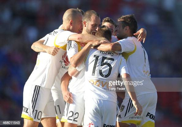 Phoenix players celebrate a goal during the round 18 ALeague match between the Newcastle Jets and Wellington Phoenix at Hunter Stadium on February 9...