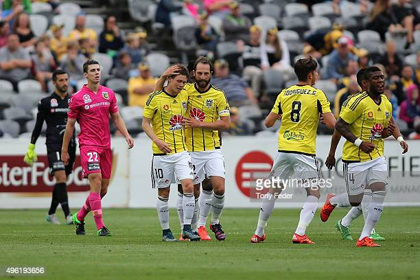 Phoenix players celebrate a goal during the round five ALeague match between the Central Coast Mariners and the Wellington Phoenix at Central Coast...
