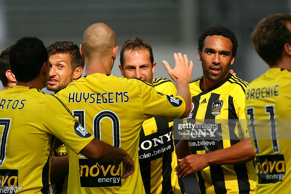Phoenix players celebrate during the round 23 A-League match between the Wellington Phoenix and the Melbourne Heart at Forsyth Barr Stadium on March 3, 2013 in Dunedin, New Zealand.