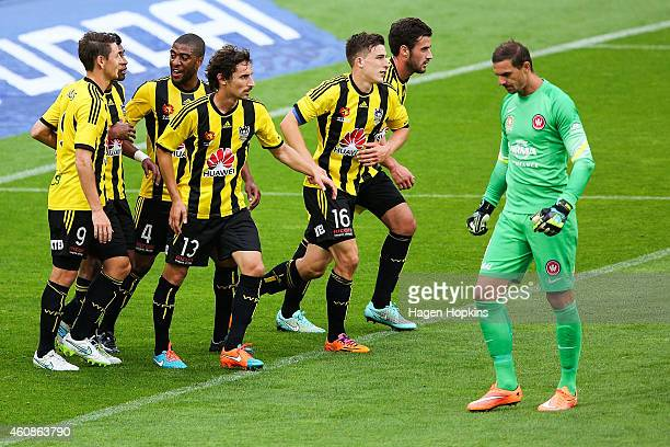 Phoenix players celebrate the goal of Roy Krishna while Ante Covic of the Wanderers looks on in disappointment during the round 13 ALeague match...