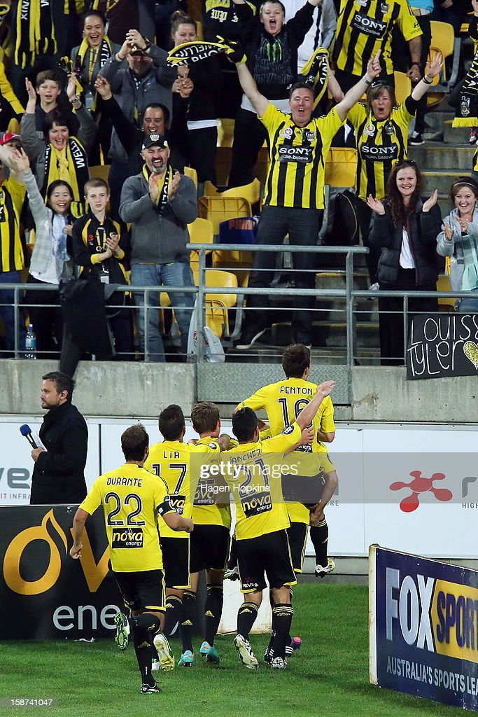 Phoenix players celebrate their second goal scored by Jeremy Brockie from the penalty spot with fans during the round 13 A-League match between the Wellington Phoenix and the Melbourne Heart at Westpac Stadium on December 27, 2012 in Wellington, New Zealand.