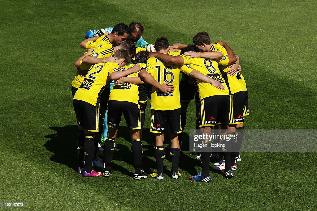Phoenix players form a huddle during the round 18 A-League match between the Wellington Phoenix and the Newcastle Jets at Westpac Stadium on January 27, 2013 in Wellington, New Zealand.